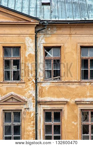 Old abandoned house in Banska Stiavnica Slovak republic. Architectural theme. Ancient house. Ruin house. Cracked wall. Impaired statics. Old architecture. Broken windows.