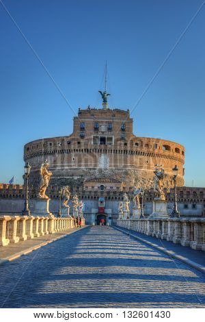 Saint Angel Castle (Castel Sant Angelo) with bridge over the Tiber river in Rome, Italy
