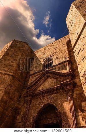 Castel del Monte: the main facade: portal.-ITALY(Apulia)-Unesco world heritage site.Castle entrance built into the octagonal towers.