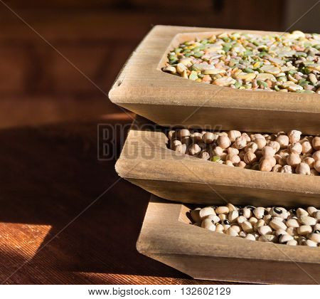 Legumes in wooden containers. legumes are an excellent food, very complete for this reason they are good substitutes for meat, fish