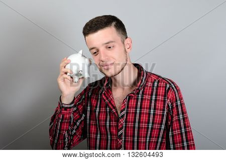 Man With Piggy Moneybox Isolated On Grey Background