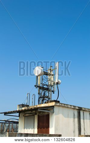 High mast metal structure telecommunication on tower with blue sky.