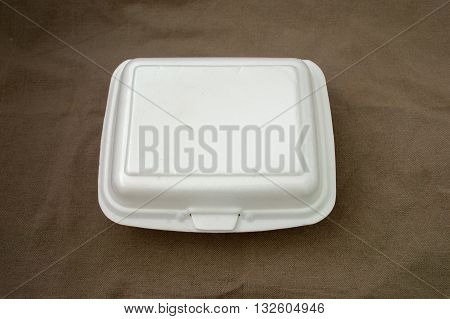 Foam boxes rice package on brown cloth