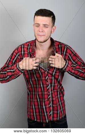 Closeup Portrait, Young Man Opening Shirt To Vent