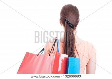 Back View Of Woman Carrying Shopping Bags On Shoulder