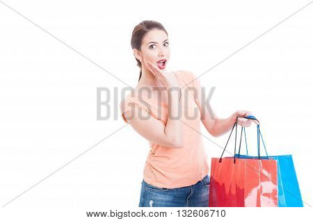 Surprised And Excited Woman Holding Shopping Bags