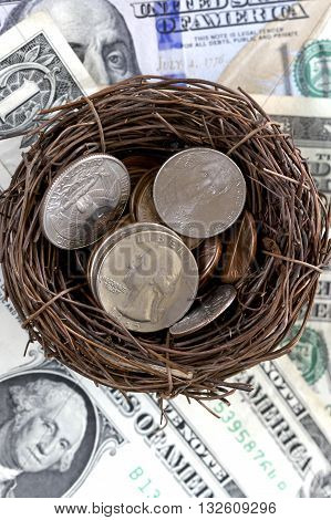 American coins in a bird's nest with a background of US dollars.