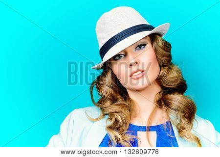 Bright summer style. Beautiful young woman in hat. Cosmetics, bright make-up.