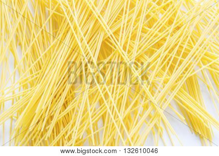 The spaghetti placed severely disrupted on white backgroud
