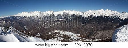 View of the main Caucasian ridge from the top of Rose Peak. The ski resort of Rosa Khutor in Krasnaya Polyana. Sochi, Russia