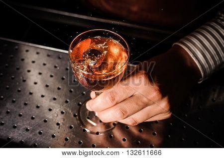Barman at work, serving cocktails at bar . no face