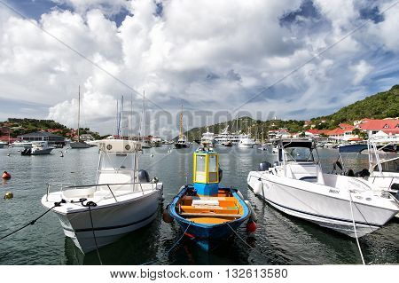Gustavia st.Barts-November 25 2015: Different yacht docked on water in bay sunny day with clouds on sky outdoor