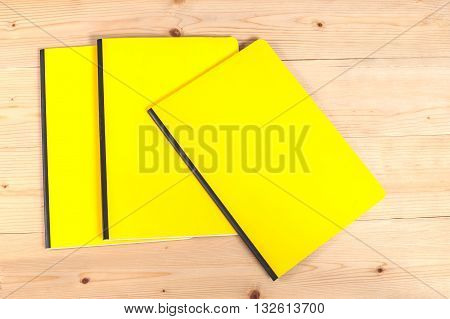 blank yellow cover book on wood table