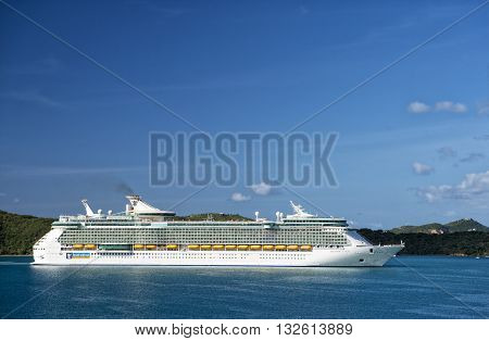 Philipsburg St.Maarten Netherlands-January 13 2016: Royal Caribbean Cruise passenger ship Freedom of the seas sailing in bay of Philipsburg st.Maarten at sunny day on blue water and clear sky background