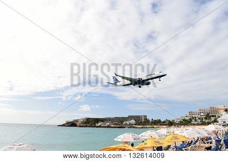 Plane Above Beach Water