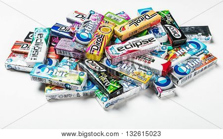 Moscow RUSSIA - May 24 2016: various brand chewing gum on a white background. bubble gum brands Orbit Dirol Eclipse Stimorol Wrigley Spearmint
