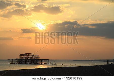 Remains of Brighton Pier left standing in sea at sunset, Brighton West Pier, England, UK