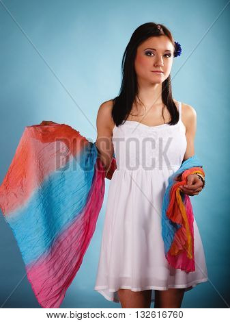 Summer fashion. Beauty young woman fashionable sensual girl with coloured shawl on blue background