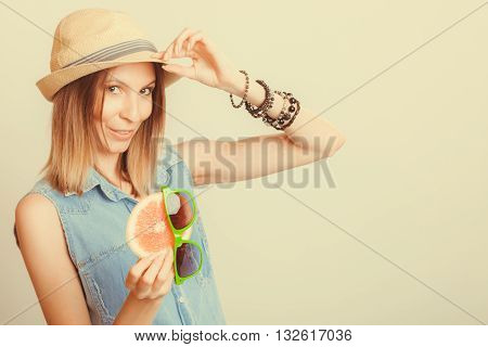 Happy Woman In Hat Holds Sunglasses And Grapefruit