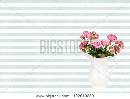 Pink flowers in white jug on watercolor blue stripes background. Roses in jug on Light Cyan watercolor striped background. Background with flowers. Background with pink roses.