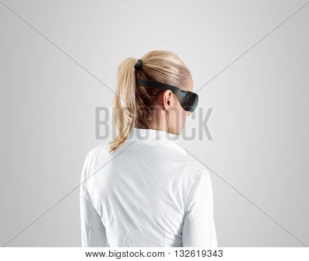 Virtual reality glasses, wear on woman, isolated, clipping path. Shirt person stand back looking in 3d cyber headset display. Wearable vr computer head set goggles watching. Man gaming glasses screen.