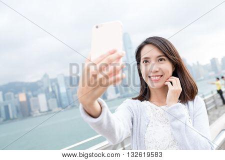 Woman taking self photo