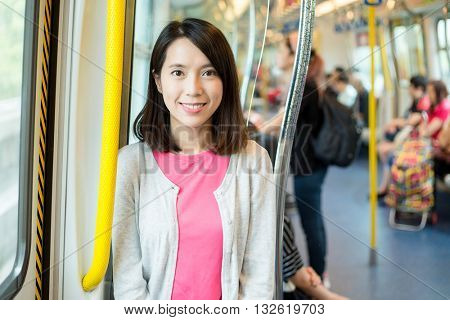 Asian woman inside train compartment
