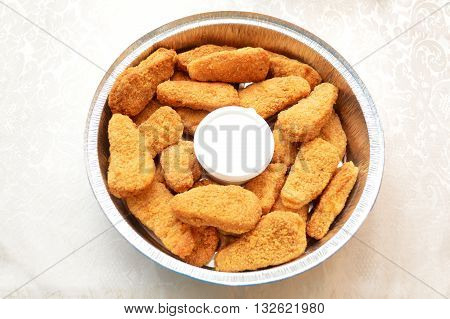 Chicken Nuggets with Ranch Dipping Sauce in a Takeout Container