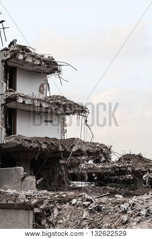 Urban scene. Dismantling of a house. Ruins of building under destruction. Industry.