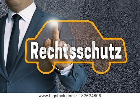 Rechtsschutz (in German Legal Protection) Car Touchscreen Is Operated By Businessman Concept
