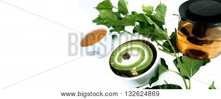 Cake tea matcha green tea for print or promote Prob have Mulberry leaf in my plant and green tea in pot ceramic cup background white color have Space areas keep left for your word or logo