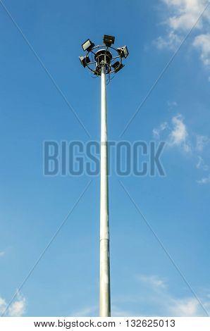 Spot light pole with blue sky and cloud