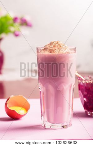 Egg nog (Scottish egg cocktail) with cream milk and raspberry jem