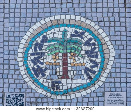 JERUSALEM ISRAEL - FEBRUARY 27: Mosaic on the street of Jerusalem it depicts an ancient Jewish coin in Jerusalem Israel on February 27 2016