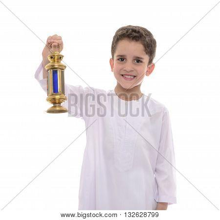 Portrait Of Muslim Boy In White Djellaba Celebrating Ramadan