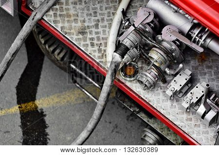 Detail with heavy duty water hoses on a firefighter vehicle