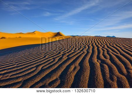 Magnificent sandy waves on dunes. Death Valley, California. Early morning, sunrise