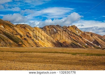 The valley of national park Landmannalaugar in warm sunlight of July. Magnificent Iceland in the summer