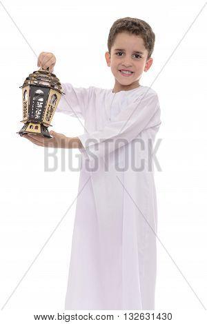 Muslim Boy In White Djellaba With Lantern Celebrating Ramadan