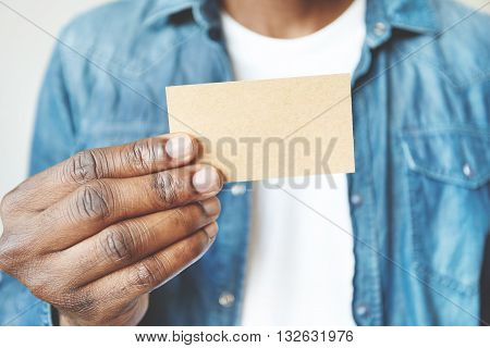 Close Up Of African Man's Hands Holding Business Card With Copy Space For Your Text Or Advertising C