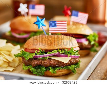 burgers and potato chips with american flags patriotic theme