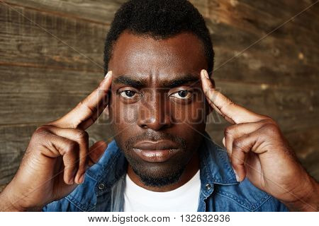 African Student In Denim Shirt Trying To Remember Something Important While Preparing For Final Exam