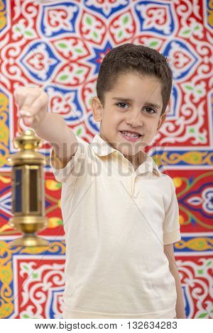 Happy Smiling Young Boy Celebrating Ramadan With Lantern