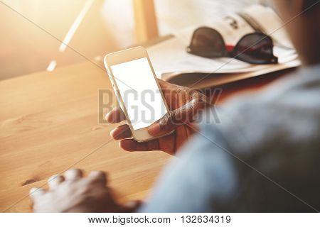 Close Up Shot Of Black Man's Hands Holding Cell Phone With Blank Copy Space Screen For Your Text. Af