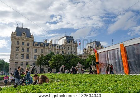 Paris France - May 14 2015: French People in Cite Island Paris France. on May 14 2015. It is the centre of Paris and the location where the medieval city was refounded.