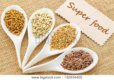 Super food tag with fenugreek seeds bukwheat seeds gold linseeds and brown linseeds.