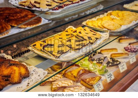 AIX-EN-PROVENCE FRANCE - JUL 17 2014: French traditional bakery pastry store in the center of AIX with diverse cakes and eclairs