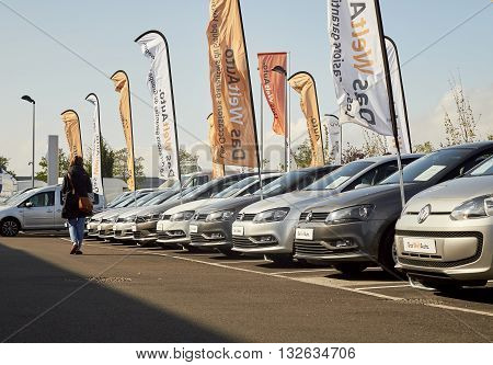 STRASBOURG FRANCE - OCT 10 2015: Woman walking through rows of Volkswagen cars choosing the right model