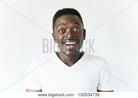 People And Lifestyle Concept. Happy Excited African Student In Casual White T-shirt Looking At The C