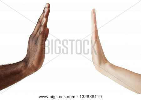 Close Up View Of Black Male And White Female Hands Giving A Five Isolated Against White Studio Wall,